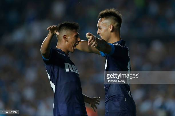 Lautaro Martinez of Racing Club celebrates with teammates after scoring the third goal of his team during a match between Racing Club and Huracan as...