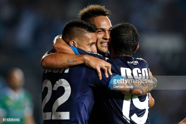 Lautaro Martinez of Racing Club celebrates with teammates after scoring the fourth goal of his team during a match between Racing Club and Huracan as...