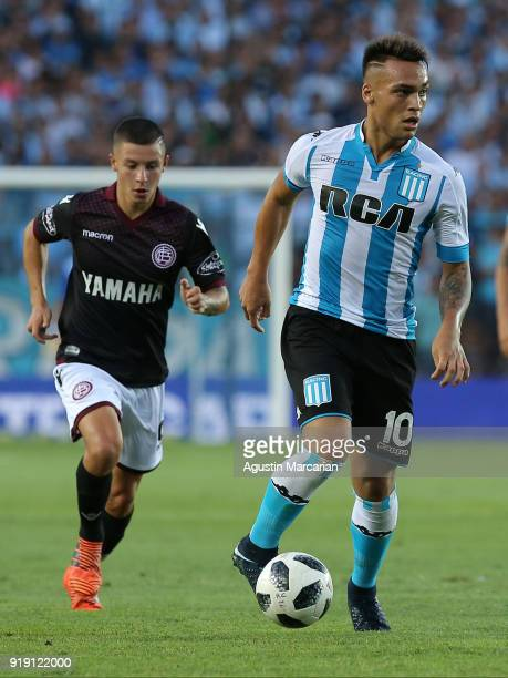 Lautaro Martinez of Racing Club controls the ball followed by Nicolás Thaller of Lanus during a match between Racing Club and Lanus as part of...
