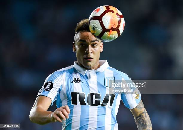 Lautaro Martinez of Racing Club drives the ball during a group stage match between Racing Club and Universidad de Chile as part of Copa CONMEBOL...