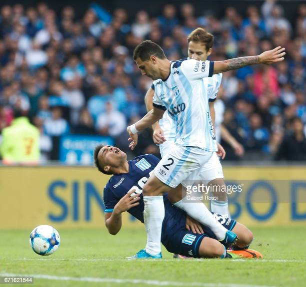 Lautaro Martinez of Racing Club falls to the ground after colliding Bruno Bianchi of Atletico de Tucuman during a match between Racing and Atletico...