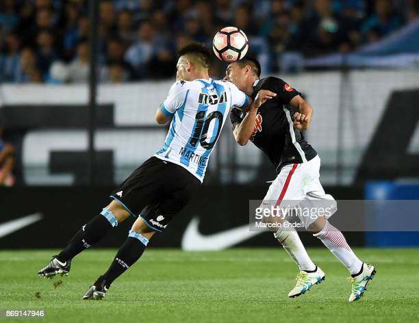 Lautaro Martinez of Racing Club fights for the ball with Angel Cardozo of Libertad during a second leg match between Racing Club and Libertad as part...