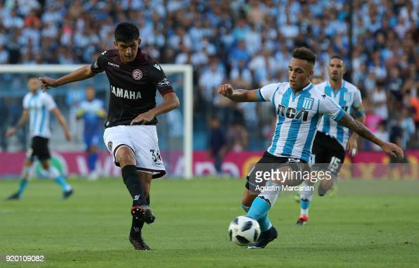 Lautaro Martinez of Racing Club fights for the ball with Enzo Ortiz of Lanus during a match between Racing Club and Lanus as part of Argentine...