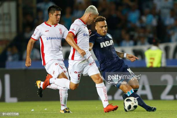 Lautaro Martinez of Racing Club fights for the ball with Israel Damonte of Huracan during a match between Racing Club and Huracan as part of...