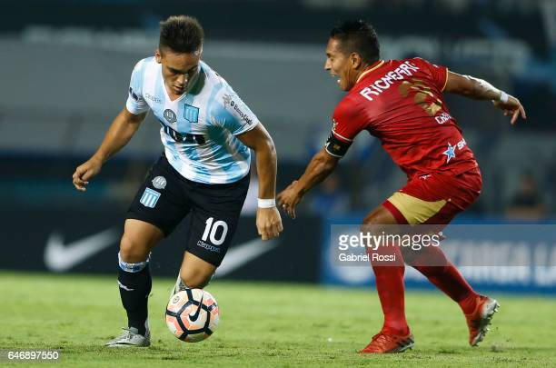 Lautaro Martinez of Racing Club fights for the ball with John Javier Restrepo of Rionegro Aguilas during a first leg match between Racing and...
