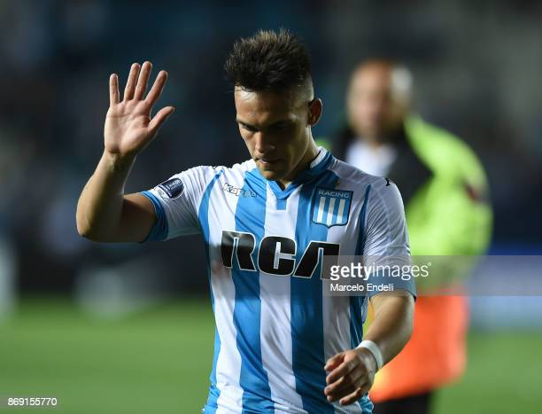 Lautaro Martinez of Racing Club leaves the field as he greets the fans after being disqualified during a second leg match between Racing Club and...