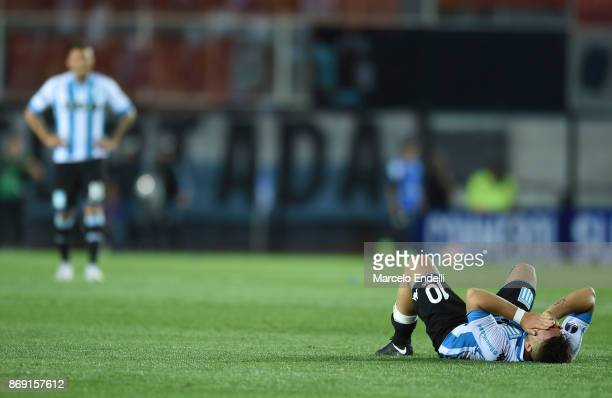 Lautaro Martinez of Racing Club looks dejected after being disqualified during a second leg match between Racing Club and Libertad as part of the...