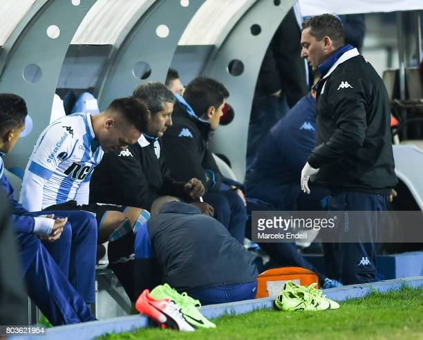 Lautaro Martinez of Racing Club receives medical attention after being injured during the first leg match between Racing Club and Independiente...