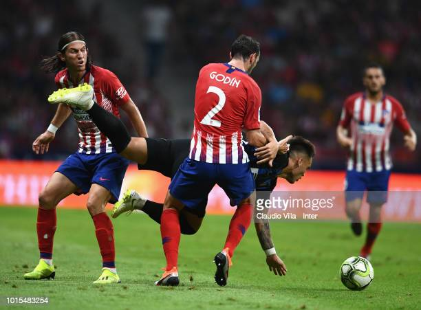 Lautaro Martínez of FC Internazionale and Diego Godin of Atletico Madrid compete for the ball during the International Champions Cup 2018 match...