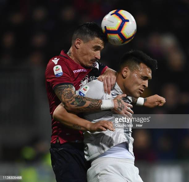 Lautaro Martínez of FC Internazionale and Fabio Pisacane of Cagliari compete for the ball during the Serie A match between Cagliari and FC...