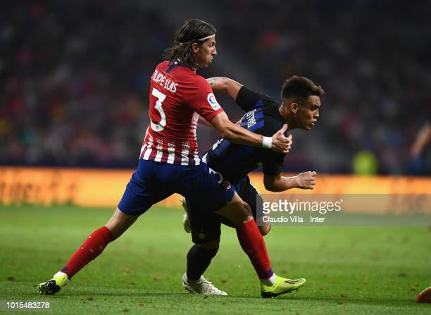 Lautaro Martínez of FC Internazionale and Filipe Luís of Atletico Madrid compete for the ball during the International Champions Cup 2018 match...