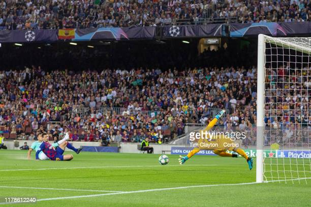 Lautaro Martínez of Internazionale scores his sides early goal beating challenge of Clément Lenglet of Barcelona and goalkeeper MarcAndré ter Stegen...