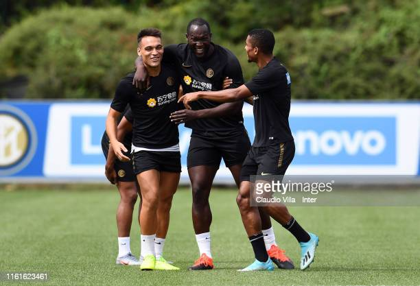 Lautaro Martínez, Romelu Lukaku and Dalbert Henrique Chagas Estevão of FC Internazionale chat during a FC Internazionale training sessionat Appiano...