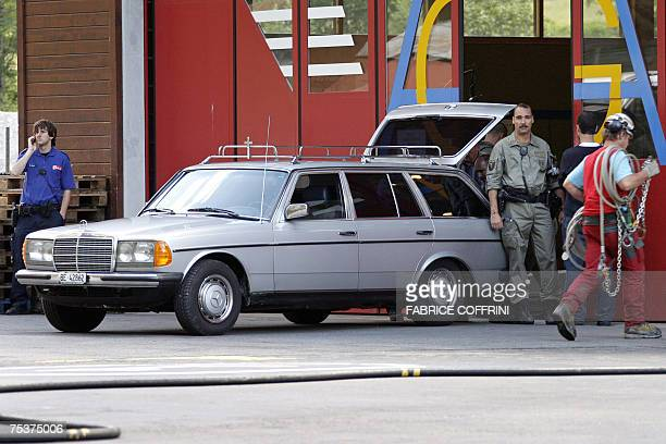 A hearse carrying the coffin of one of six soldiers is seen 12 July 2007 at the air rescue base of Lauterbrunnen in the Bernese Oberland region...