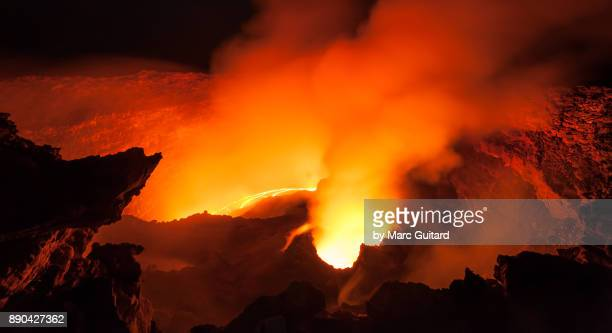 Lava and smoke thrash inside the crater of Erta Ale, an extremely active shield volcano located in the Danakil Depression in the Afar Region of Ethiopia
