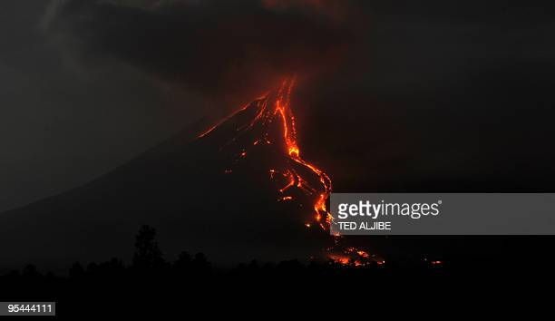 Lava cascades down the slopes of Mayon volcano in Legazpi City Albay province southeast of Manila late December 25 2009 More than 47000 people have...