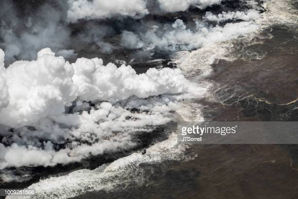 lava entering the sea - pele goddess stock pictures, royalty-free photos & images