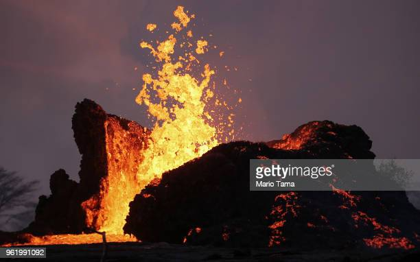 Lava erupts and flows from a Kilauea volcano fissure in Leilani Estates on Hawaii's Big Island on May 23 2018 in Pahoa Hawaii Officials are concerned...