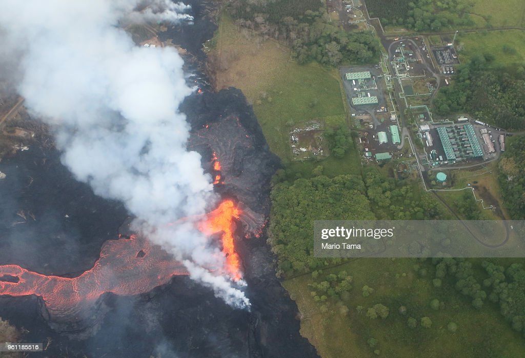 Lava erupts and flows from a Kilauea volcano fissure, near to the Puna Geothermal Venture (PGV) plant (TOP R), on Hawaii's Big Island on May 21, 2018 near Pahoa, Hawaii. Officials are concerned that 'laze', a dangerous product produced when hot lava hits cool ocean water, will affect residents. Laze, a word combination of lava and haze, contains hydrochloric acid steam along with volcanic glass particles.