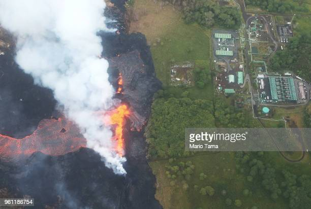 Lava erupts and flows from a Kilauea volcano fissure near to the Puna Geothermal Venture plant on Hawaii's Big Island on May 21 2018 near Pahoa...
