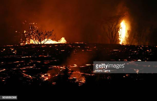 Lava erupts and flows from a Kilauea volcano fissure on Hawaii's Big Island on May 18, 2018 in Kapoho, Hawaii. The U.S. Geological Survey said the...