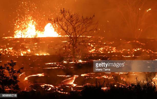 Lava erupts and flows from a Kilauea volcano fissure on Hawaii's Big Island on May 18 2018 in Kapoho Hawaii The US Geological Survey said the volcano...