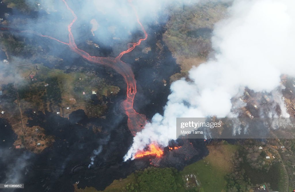 Lava erupts and flows from a Kilauea volcano fissure, towards the Pacific Ocean, on Hawaii's Big Island on May 21, 2018 near Pahoa, Hawaii. Officials are concerned that 'laze', a dangerous product produced when hot lava hits cool ocean water, will affect residents. Laze, a word combination of lava and haze, contains hydrochloric acid steam along with volcanic glass particles.