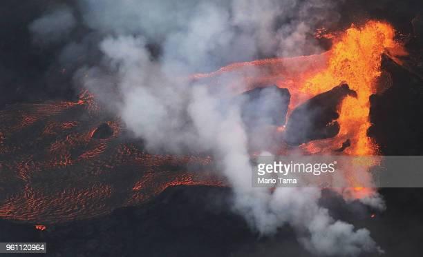 Lava erupts and flows from a Kilauea volcano fissure towards the Pacific Ocean on Hawaii's Big Island on May 21 2018 near Pahoa Hawaii Officials are...