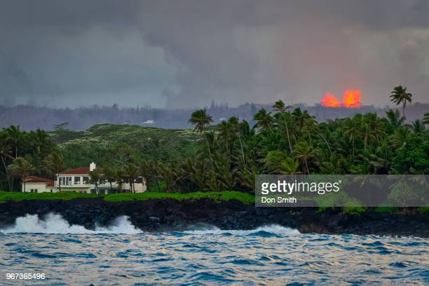 Lava erupts from Fissure 8 Fountain in Leilani Estates as seen from the Kapoho coast on the east side of the Big Island of Hawaii on May 31 2018 in...