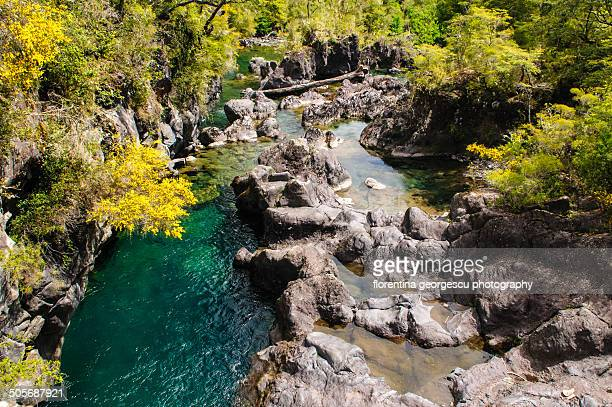 lava field and rio petrohue - petrohue river stock photos and pictures
