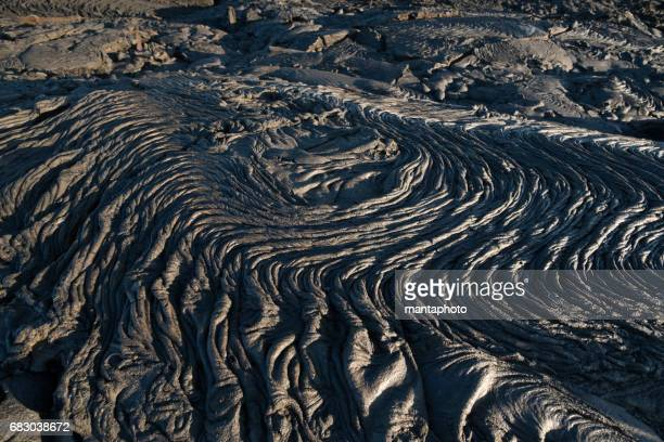 lava field - volcanic terrain stock photos and pictures
