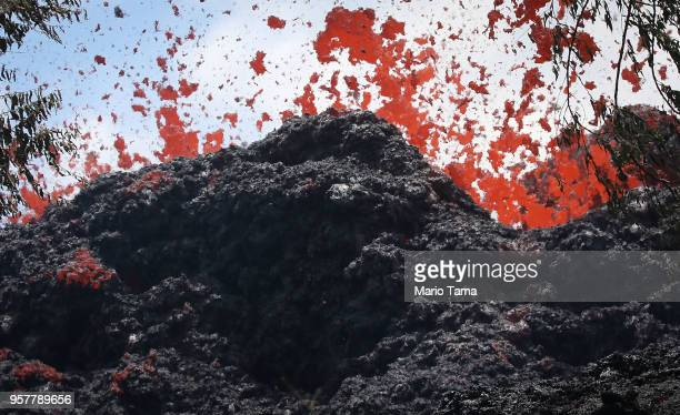 A lava fissure erupts in the aftermath of eruptions from the Kilauea volcano on Hawaii's Big Island on May 12 2018 in Pahoa Hawaii The US Geological...