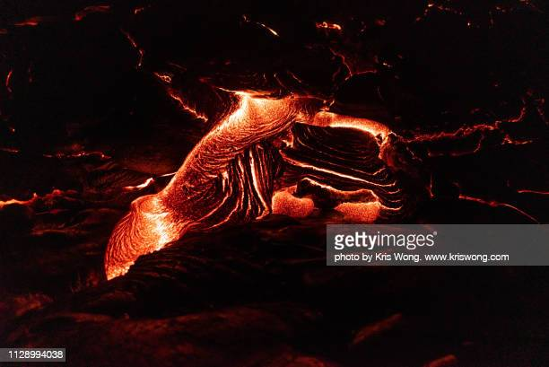 lava flow at night - pele goddess stock pictures, royalty-free photos & images