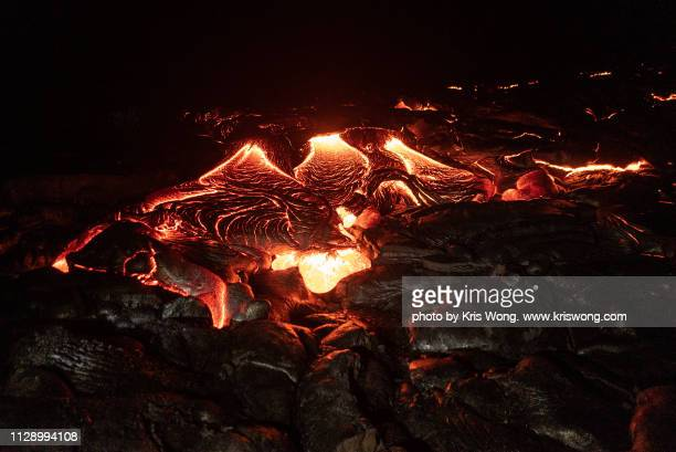 lava flow at night - pele stock pictures, royalty-free photos & images