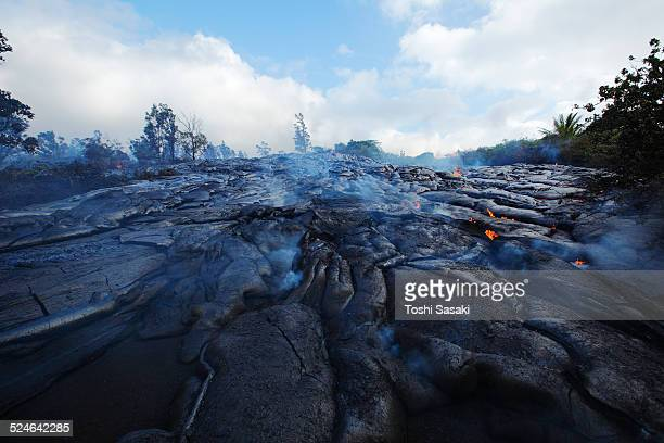 lava flow cover the asphalt road. - kalapana stock pictures, royalty-free photos & images