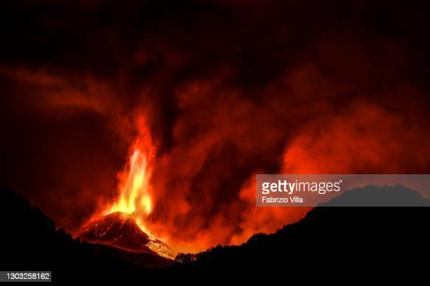 Lava flow generated by an overflow on the eastern flank of the cone heads into the Bove valley on February 21, 2021 in Catania, Italy. The South-East...