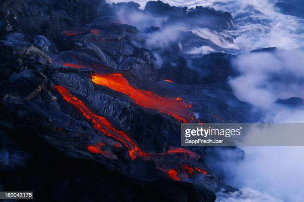 Lava flow in Hawaii flowing into the ocean