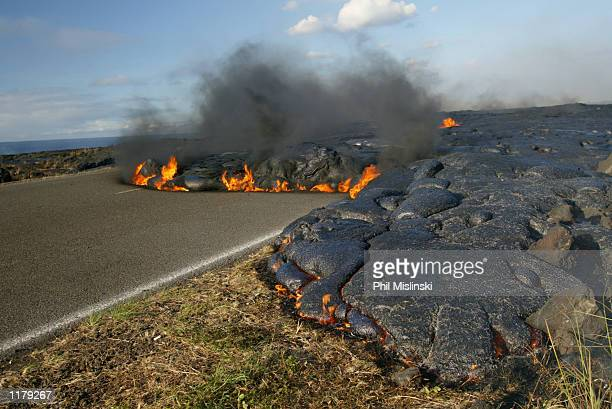 A lava flow runs over Chain of Craters Road in Volcano National Park On July 27 Kilauea's lava flow increased resulting in additional forest fires...
