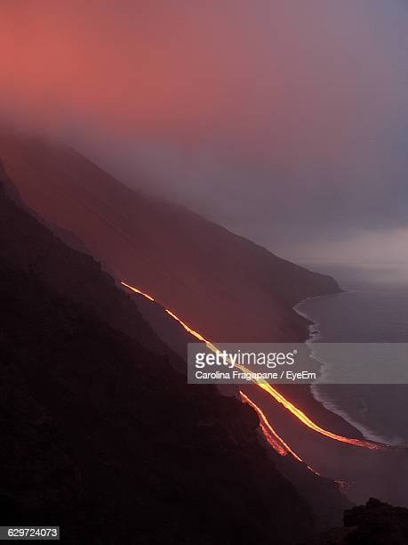 lava flowing in sea against sky - carolina fragapane stock pictures, royalty-free photos & images
