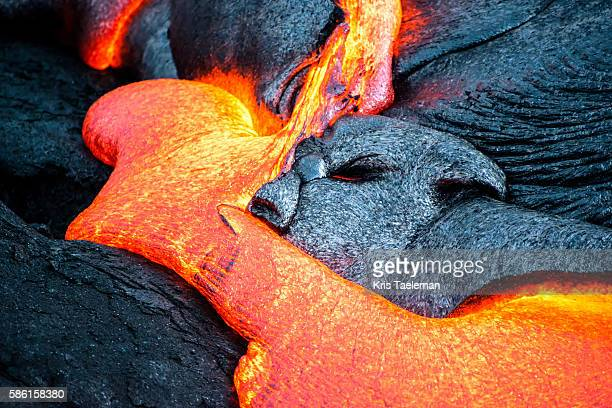 lava flowing out of the kilauea volcano on the big island of hawaii. - lava stock pictures, royalty-free photos & images