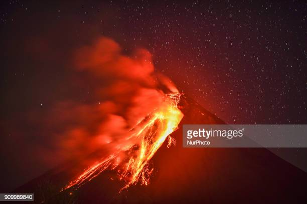 Lava flows down the slope of Mount Mayon as seen from Legazpi Albay province Philippines on the evening of January 23 2018 Mount Mayon the...