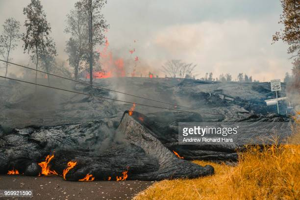 Lava flows from Fissure 21 in the aftermath of eruptions from the Kilauea volcano on Hawaii's Big Island on May 17 2018 in Pahoa Hawaii The US...
