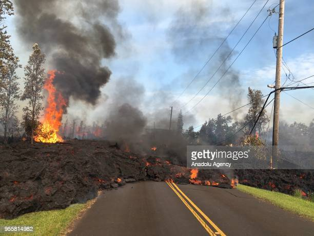 Lava flows from the crater of Kilauea volcano as dozens of structures including at least nine homes have been destroyed by scorching lava flows...