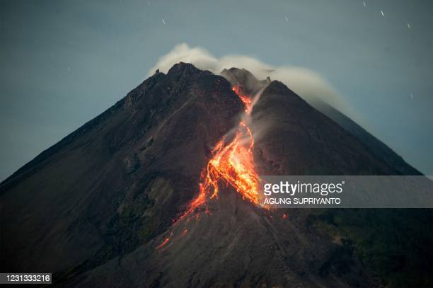 Lava flows from the crater of Mount Merapi as seen from Tunggularum, in Yogyakarta on February 23, 2021.