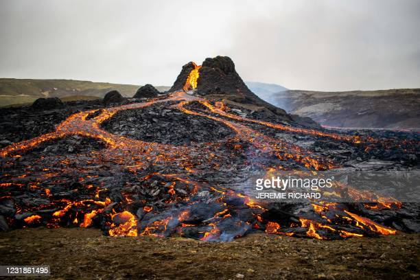 Lava flows from the erupting Fagradalsfjall volcano some 40 km west of the Icelandic capital Reykjavik, on March 21, 2021. - Weekend hikers took the...