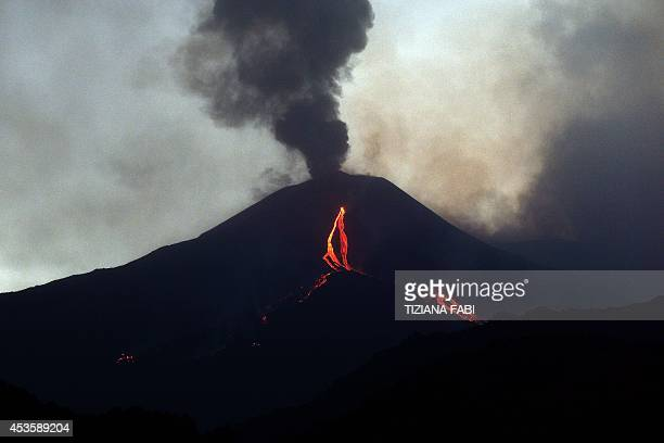 Lava flows from the Mount Etna volcano on the southern Italian island of Sicily near Catania on August 14 2014 Mount Etna is one of the most active...