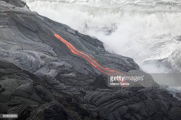 Lava flows into the ocean from Kilauea Volcano at Volcanoes National Park near Volcano Hawaii June 6 2004 Lava from Kilauea has reached the ocean for...