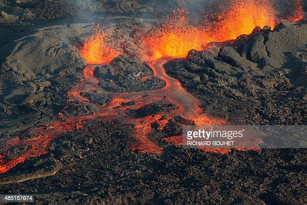 Lava flows out of the Piton de la Fournaise volcano one of the world's most active volcanoes as it erupts on August 25 on the French island of La...