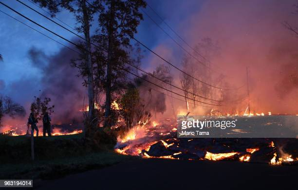 Lava from a Kilauea volcano fissure advances up a residential street in Leilani Estates on Hawaii's Big Island on May 27 2018 in Pahoa Hawaii Lava...