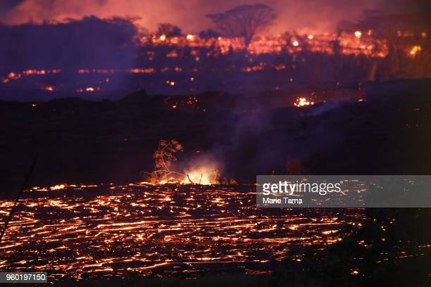 Lava from a Kilauea volcano fissure flows on Hawaii's Big Island on May 19 2018 in Kapoho Hawaii The US Geological Survey said the volcano erupted...